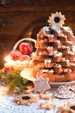 Christmas tree Pandoro with candle light Stock Photography