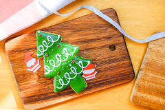 Christmas tree and paper Santa on wooden plate. Christmas tree cookie and paper Santa on wooden plate. Christmas theme table Stock Photos