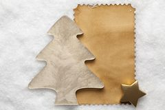 Christmas tree and paper sheet on snow background Royalty Free Stock Photo