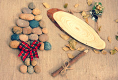 Christmas tree, pebble, wooden pen, Xmas message Stock Photo