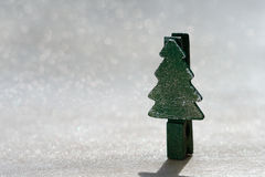 Christmas tree peg standing on glitter Stock Images
