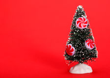 Christmas Tree with Peppermint Candy over red Royalty Free Stock Photos