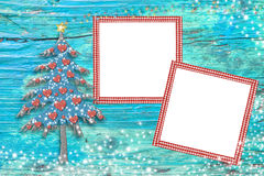 Christmas tree photo frames cards. Christmas photo frames cards, cute tree and two blank frames to put photos over a blue wooden background with stars Royalty Free Stock Images