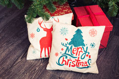 Christmas tree and pillow. Sofa decorated for Christmas with colorful pillow stock image