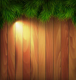 Christmas Tree Pine Branches with Light on Wooden Wall Royalty Free Stock Image