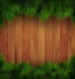 Christmas Tree Pine Branches Like Frame on Wooden Wall Royalty Free Stock Images