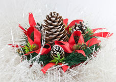 Christmas tree with a pinecone. In tinsel Royalty Free Stock Photo