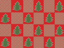 Christmas Tree Plaid. Christmas trees on alternating red and plaid squares makes a festive holiday background Stock Images