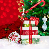 Christmas Tree, Poinsettia's & Presents. White, Gold, Silver and Red Christmas Ornaments with Candy Canes, Lollipops, Poinsettia's and Presents Over Christmas Royalty Free Stock Images