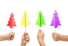 Christmas tree popsickle candy in child hands Royalty Free Stock Photography