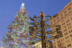 Christmas Tree in Portland Pioneer Square. Christmas Tree with Colorful Lights in Pioneer Courthouse Square with Directional Signs Pointing to Places Around the royalty free stock photography