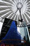 Christmas Tree at Potsdamer Plaz. Berlin, Germany - November 22, 2012: Christmas lights at the Sony Center at Potsdamer Platz. The Sony Center was designed by stock images