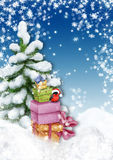 Christmas tree with present boxes and bullfinch in winter landsc Stock Images