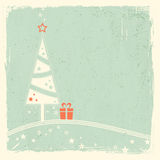 Christmas tree with present and stars Stock Image