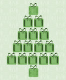 Christmas Tree Of Presents. Design of a bright, shining Christmas tree made of green presents each with a bow on top and  on a light green wallpaper design Royalty Free Stock Photography