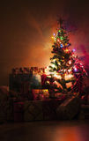 Christmas tree with presents. Around it Stock Photo