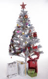 Christmas tree and presents. Artifical decorated Christmas tree with presents stock image