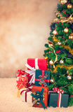 Christmas Tree and Presents. Beautifully decorated Christmas tree with many presents under it stock image