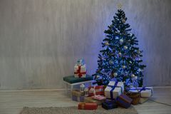 Christmas tree with presents and decorations the lights new year Garland. Christmas tree with presents and decorations the lights new year royalty free stock photo