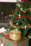 Christmas tree presents and fireplace Stock Photography