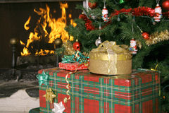Christmas tree presents and fireplace vertical Stock Image
