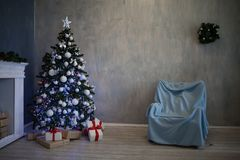 Christmas tree with presents, Garland lights new year 2018 2019 Royalty Free Stock Photography