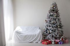 Christmas tree with presents, Garland lights new year. 1 stock image