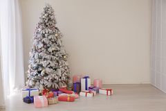 Christmas tree with presents, Garland lights new year. 1 stock photos