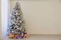 Christmas tree with presents, Garland lights new year. 4 royalty free stock photography