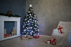 Christmas tree with presents, Garland lights new year 2018 2019 Royalty Free Stock Photo