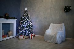 Christmas tree with presents, Garland lights new year 2018 2019 Royalty Free Stock Photos