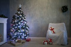 Christmas tree with presents, Garland lights new year 2018 2019 Stock Photo