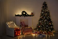 Christmas tree with presents, Garland lights new year winter holiday. Christmas tree with presents, Garland lights new year winter stock image