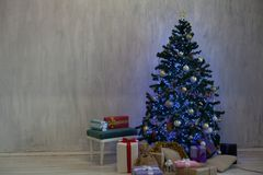 Christmas tree with presents, Garland lights new year winter holiday. Christmas tree with presents, Garland lights new year winter stock photo