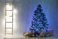 Christmas tree with presents, Garland lights new year winter holiday. Christmas tree with presents, Garland lights new year winter royalty free stock photos