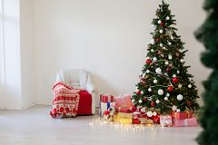 Christmas tree with presents, Garland lights new year winter holiday. Christmas tree with presents, Garland lights new year winter stock photography
