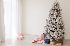 Christmas tree with presents, Garland lights new year. Christmas tree with presents, Garland new year stock image