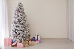 Christmas tree with presents, Garland lights new year. Christmas tree with presents, Garland new year stock photo