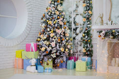 Christmas tree with presents. In the interior Stock Images