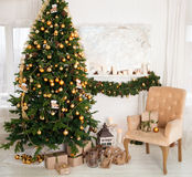 Christmas tree with presents in the living room Stock Images