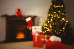 Christmas tree with presents near the fireplace Royalty Free Stock Photography