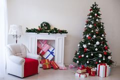 Christmas tree with presents new year holiday Garland lights. Christmas tree with presents new year holiday lights stock image