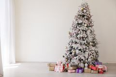 Christmas tree with presents new year white scenery. 1 royalty free stock photos