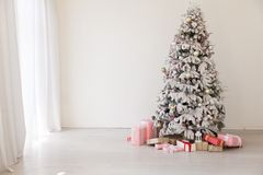 Christmas tree with presents new year white scenery. 1 royalty free stock images