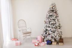Christmas tree with presents new year white scenery. 1 royalty free stock image
