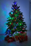 Christmas tree with presents. In the room Stock Image