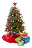 Christmas tree with presents. Small decorated Christmas tree with presents isolated on a white background stock image