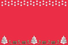 Christmas tree and presents with snowflakes. In front of a red background stock illustration