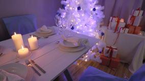 Christmas tree with presents and tableware stock video