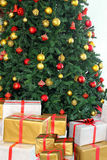 Christmas tree and presents under it Royalty Free Stock Image